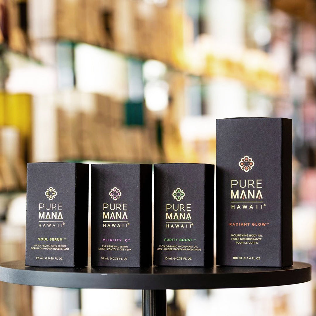 Full size bottles of Pure Mana Soul Serum, Vitality C, Purity Boost and Radiant Glow