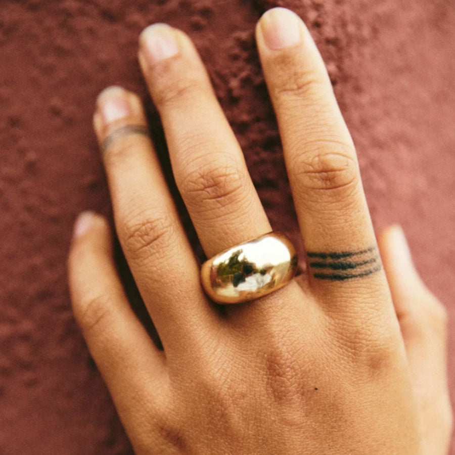 Large domed Brass Roam Vintage Eurydice Ring on hand