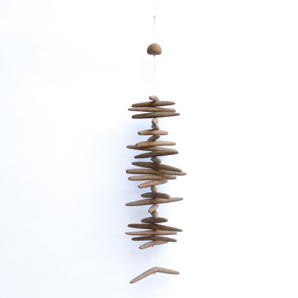 The Toothy is a hand built ceramic wall hanging with references to driftwood and other natural materials. The freeform shapes have a visceral quality, inspired by observations of landscape, the natural world, textiles, and metallic elements.
