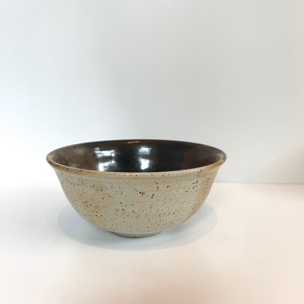 Wheel thrown small ceramic eating bowl suitable for a dish of pasta, ice cream, yogurt, cup of soup, or a very large grapefruit.