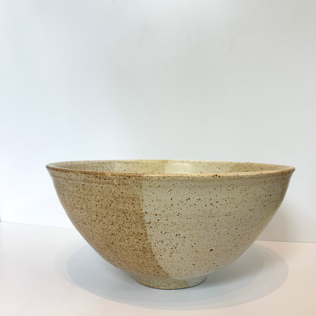 A perfect serving bowl, with Koko's inpsired pouring technique, where glaze colors overlap, kind of like how the sister's personalities run into each other.
