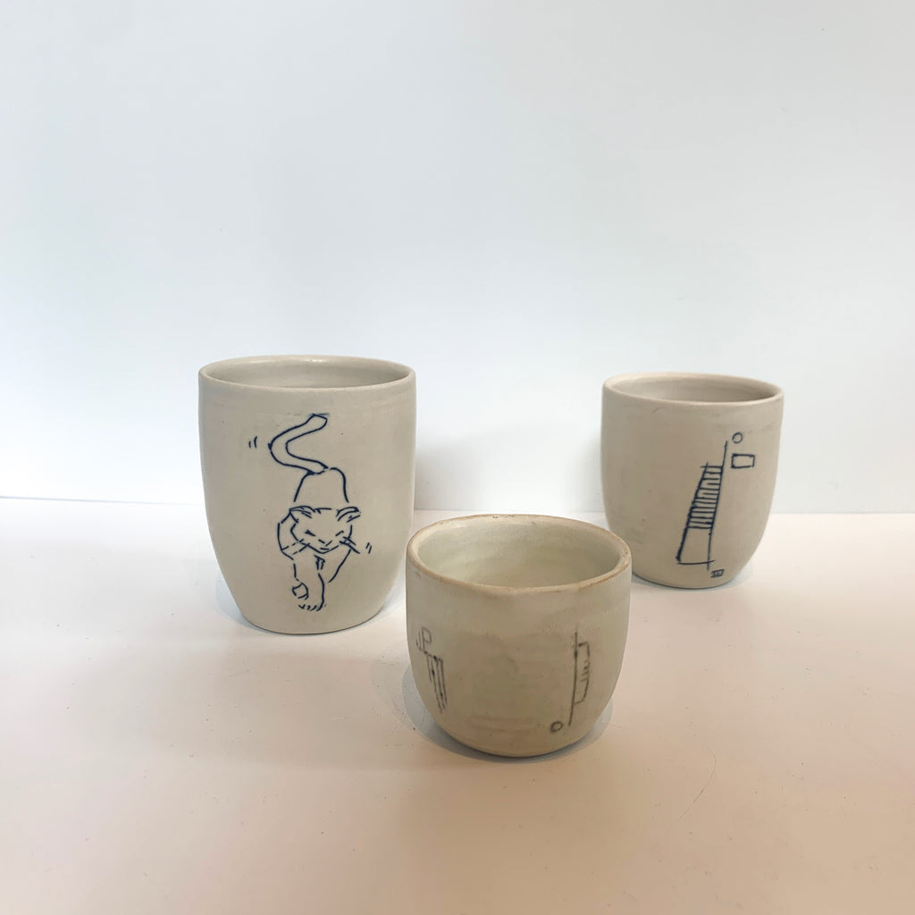 Massa is practicing. These porcelain mishima inscribed cups are part of Massa's pottery discipline and are regularly in process. Group of 3.