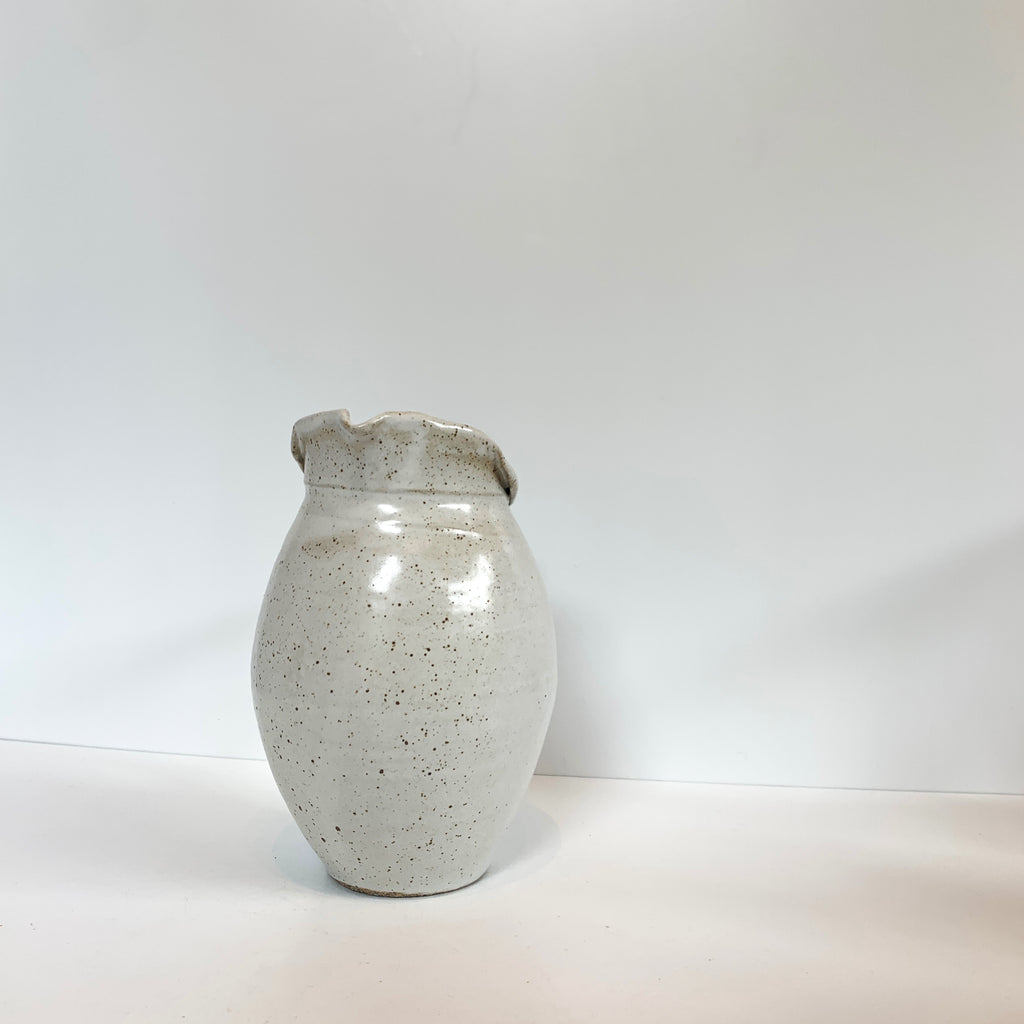 Pitchers by Massa. White on White, stoneware reduction-fired with Neph-sy glaze. Front view.