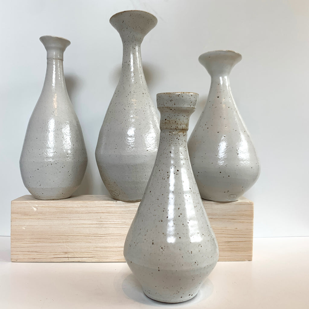 Vases by Massa. White on White, stoneware reduction-fired with Neph-sy glaze.