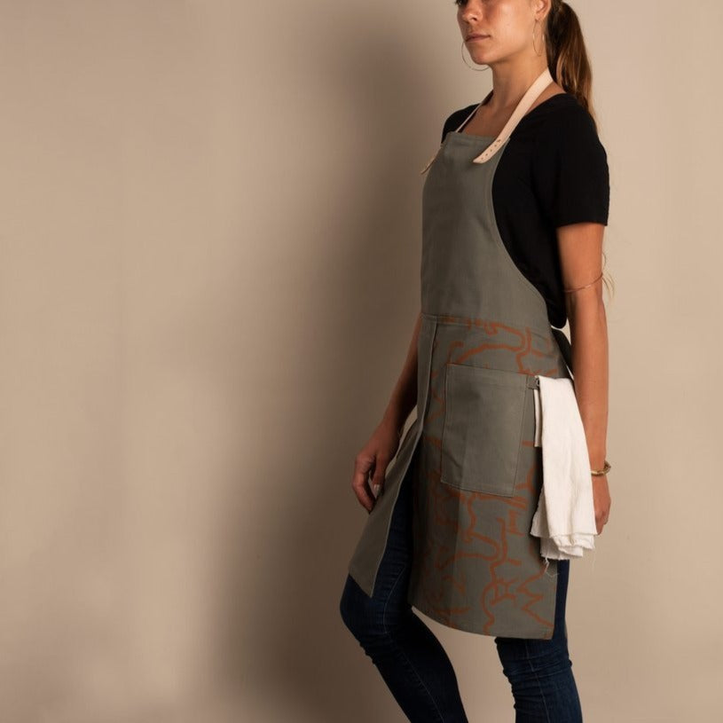 We love how Terasu imagined this limited edition canvas apron that also looks super cute over a billowing skirt! Unisex adjustable sizing and color palette. This is olive.
