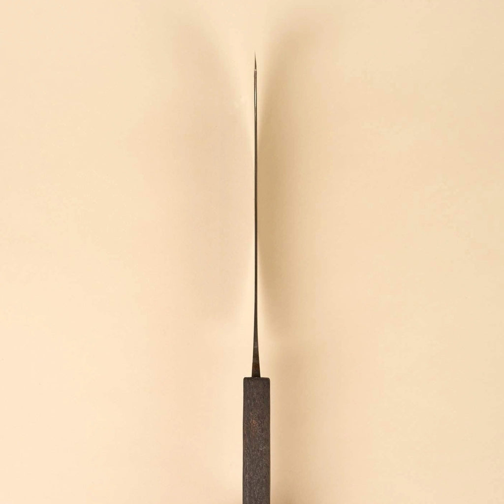 The Terasu Aogami Bread Knife by Otsuka Hamono will change your perception of slicing bread. The curve of the blade extends the cutting edge, providing the extra length needed to slice cleanly through the bottom crust.