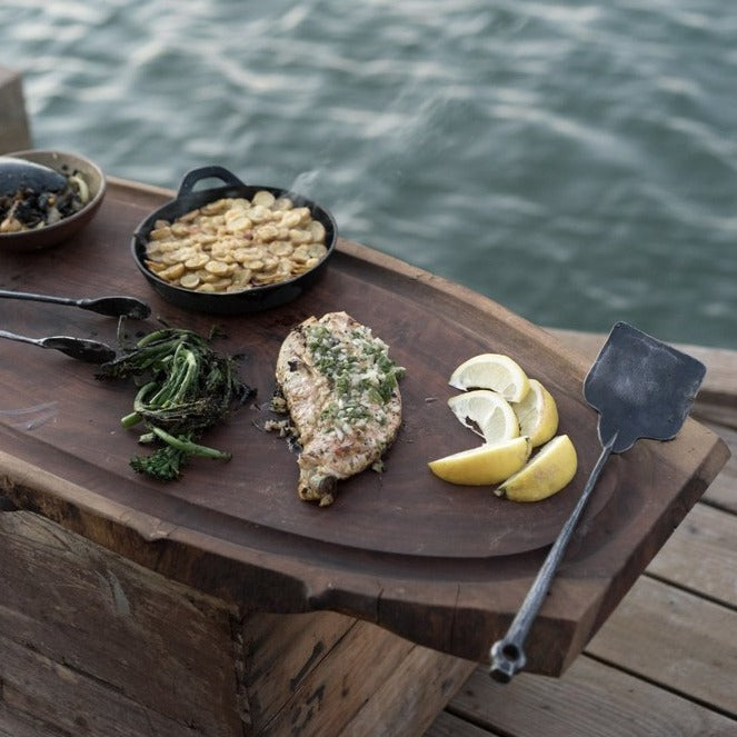 Hand forged grill spatula is both artful and functional. Bought individually or as part of a three-piece set–all pieces are beautiful and robust yet lightweight. A Terasu design collaboration between Oakland and Sausalito based metalsmiths.  Grill set shown in use.