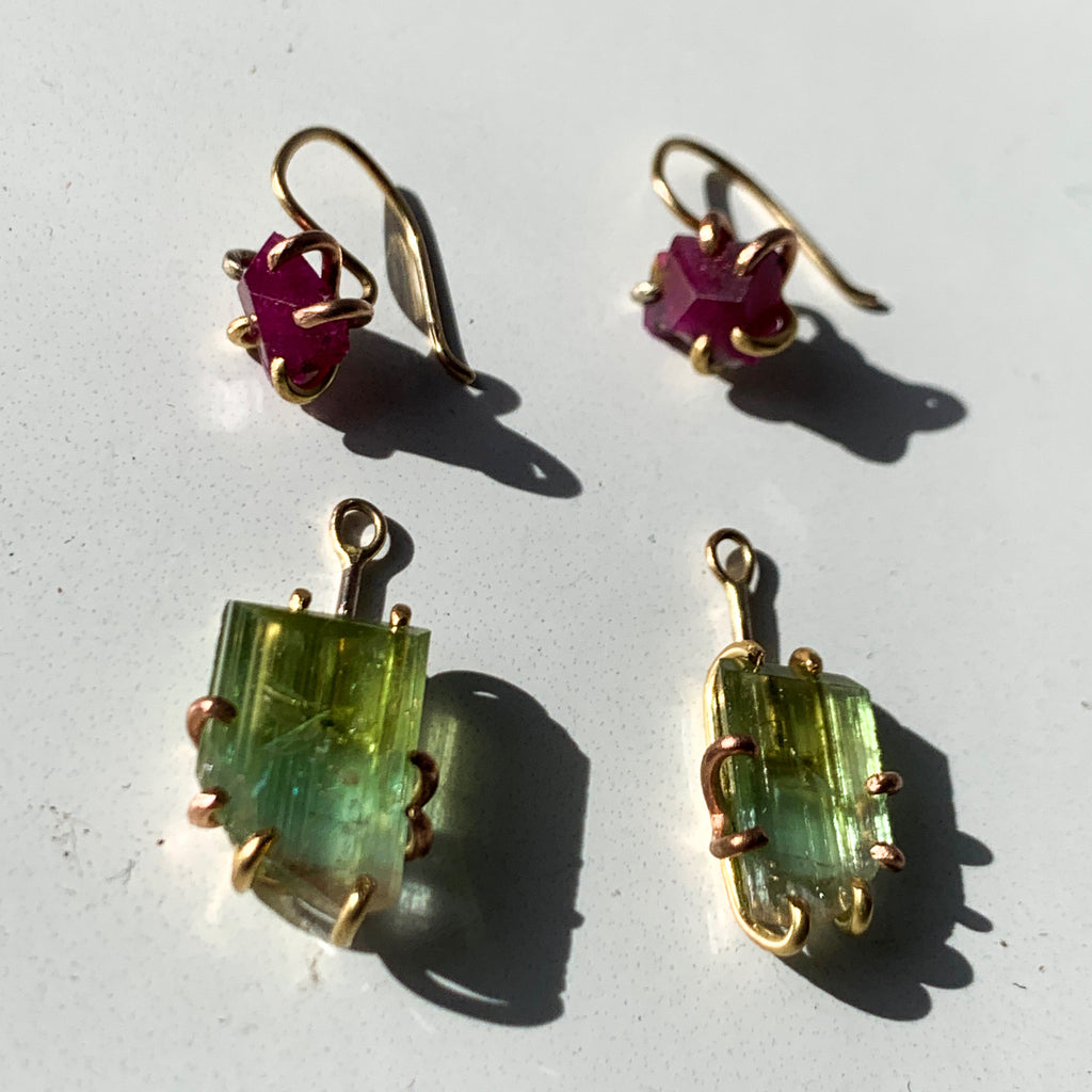 Big Ruby for everyday with detachable drops that give you modular options for that extra everything. Detachable drops have bright sea foam green Tourmaline in Variance Objects' wabi sabi approach where each is different. Mix and match the full set, ruby only, or 1 ruby and 1 detachable drop.