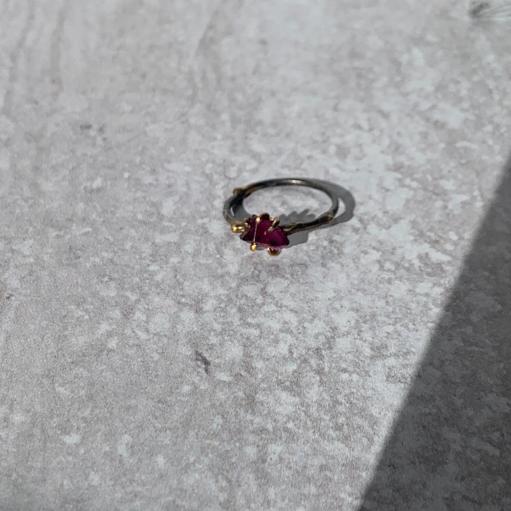 Add edge to your ring stack with Variance Objects gorgeous hand cut stones and signature mixed metal work. This deep rough garnet single stone ring captures light and pops the vibrant color.