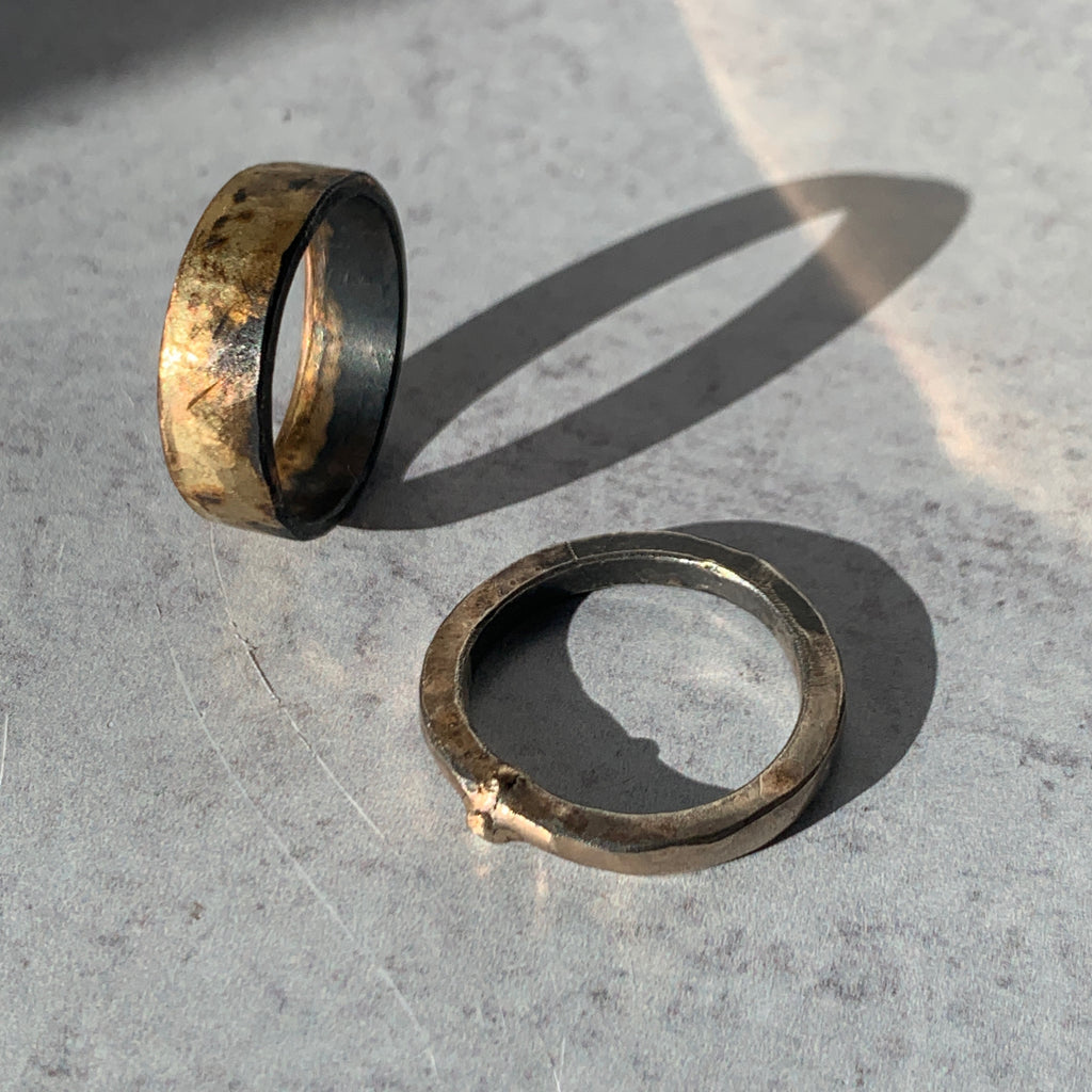 The gold and silver heavy band is made of Variance Objects gold blend of 14k-24k yellow, rose, and white gold which is embedded into oxidized sterling silver to create their signature rough beauty texture.