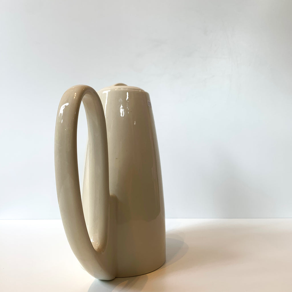 We love the sensual lines and luscious cream glaze of this porcelain carafe. Back view