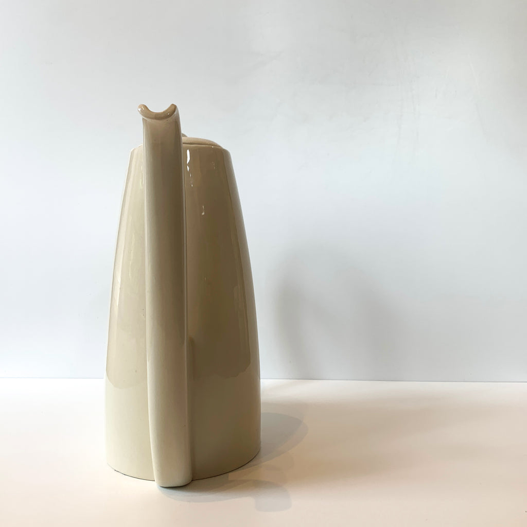 We love the sensual lines and luscious cream glaze of this porcelain carafe. Working from a home office or sharing a cuppa with a special person? What a stunning way to keep your tea and coffee service elevated! Front view.