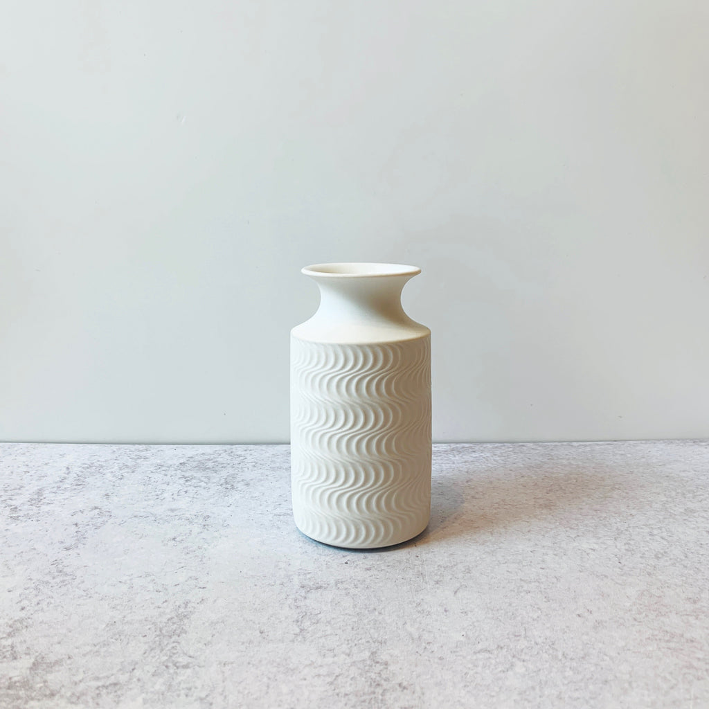 Stunning porcelain vase by Kaiser from West Germany of the Op Art period of the mid 1960's. Op Art is short for Optical Art and the illusions created by the design. This is a fab collector object we found in Bavaria to add a fresh pop of white to your decor.