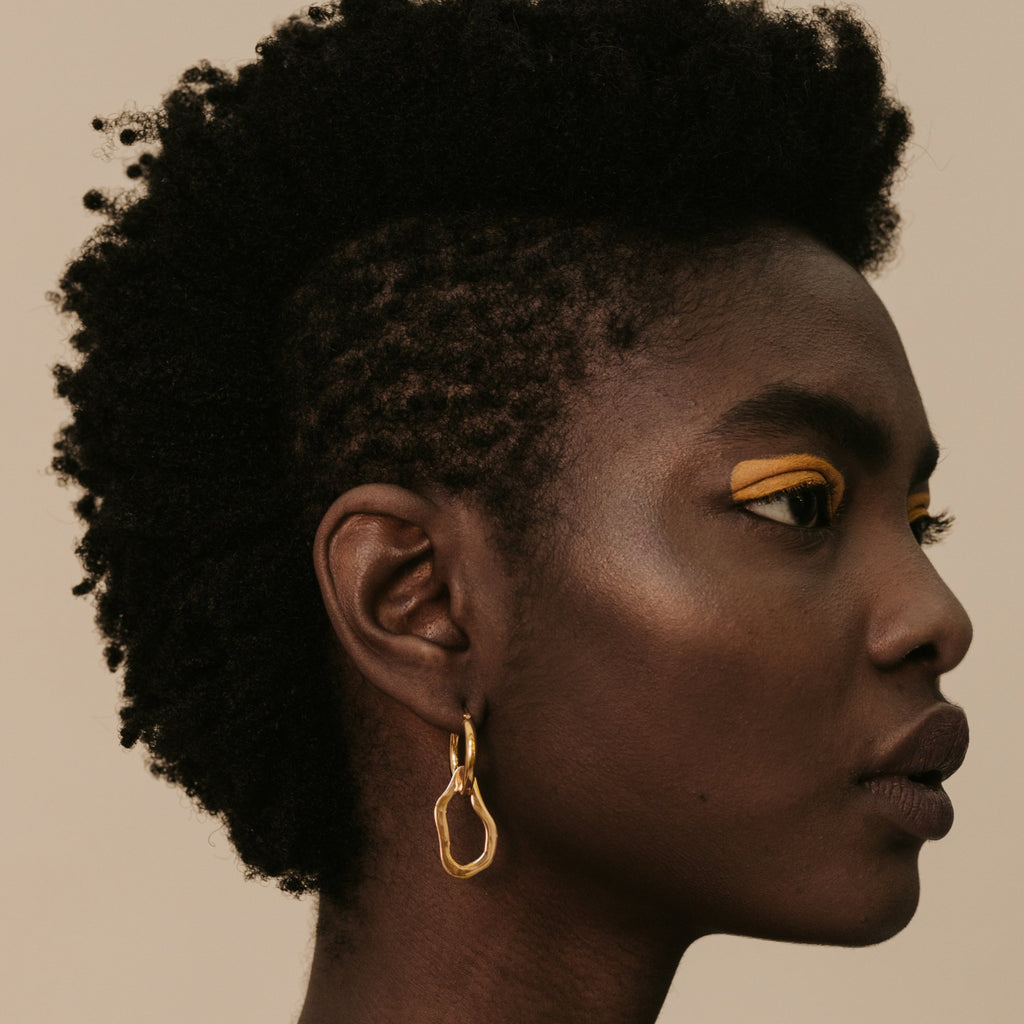 Yellow Jewellery sculptural jewelry. Mini Fred Hoops on model.