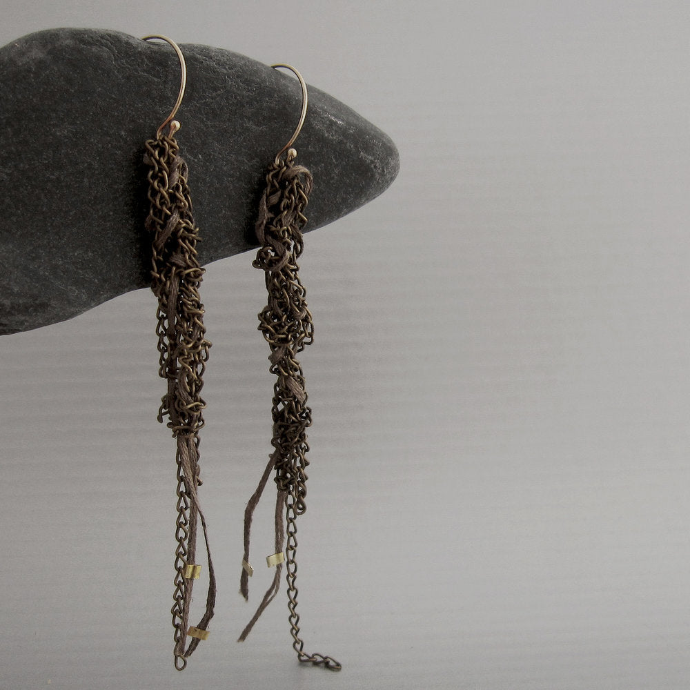 "Tiny caterpillars (""bruchini"" in the language of the designer) inspired the design of these delicate and light-weight bronze and gold earrings. Hanging with brown thread."