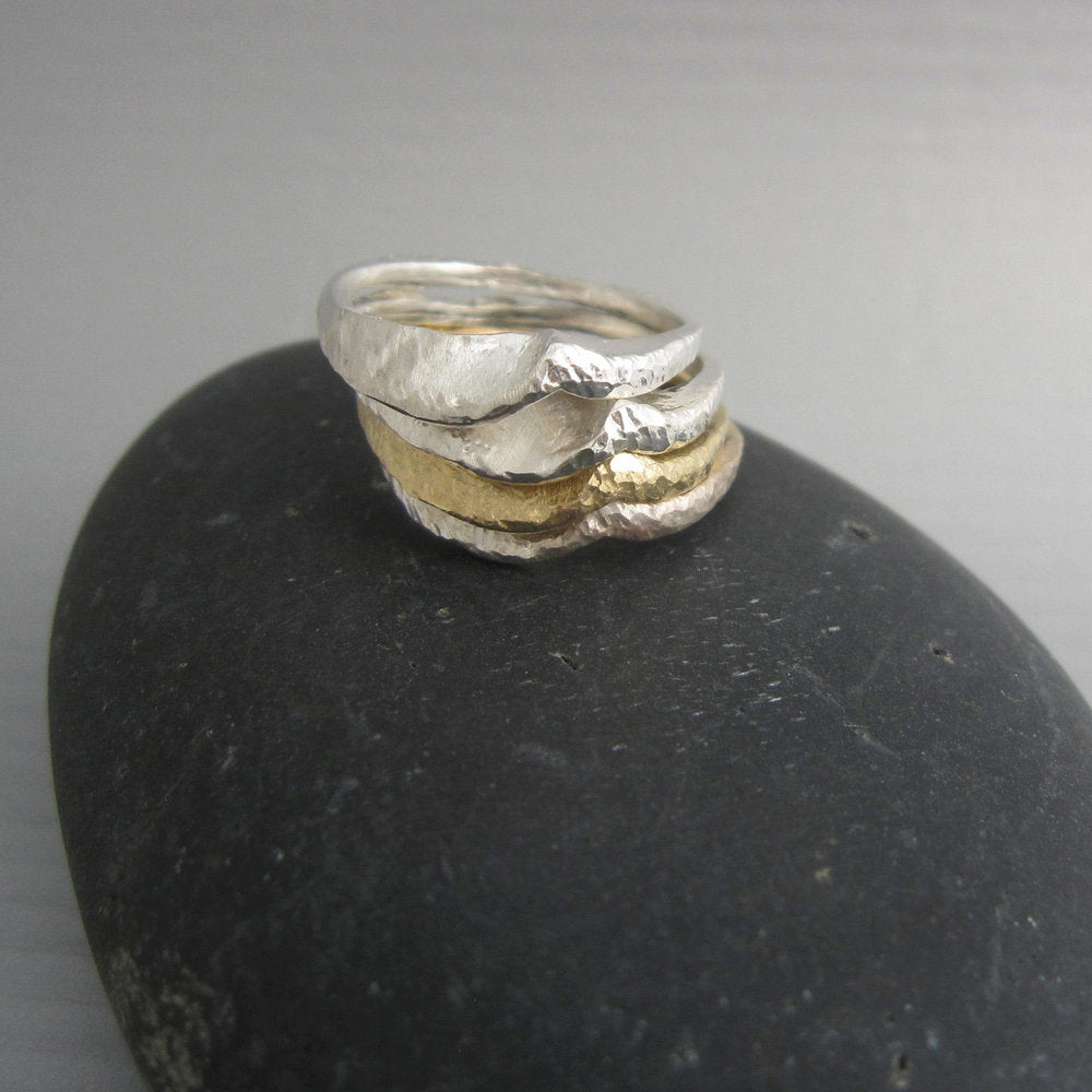 "The wave (""onda"" in Italian) ring by Maddalena Bearzi is beautiful to wear alone, but it creates elegant ocean swells when combined with other ""onda"" rings of the same or different metals. Shown in stack with other Onda rings in silver and bronze."