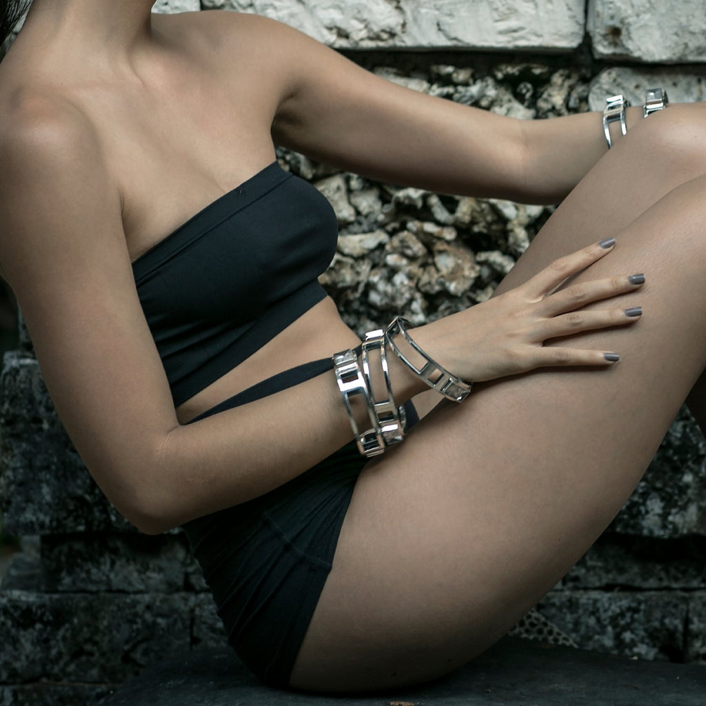 Catch rays of light with this double rough hewn rock crystal bracelet by Mariella Pilato. Shown on model.