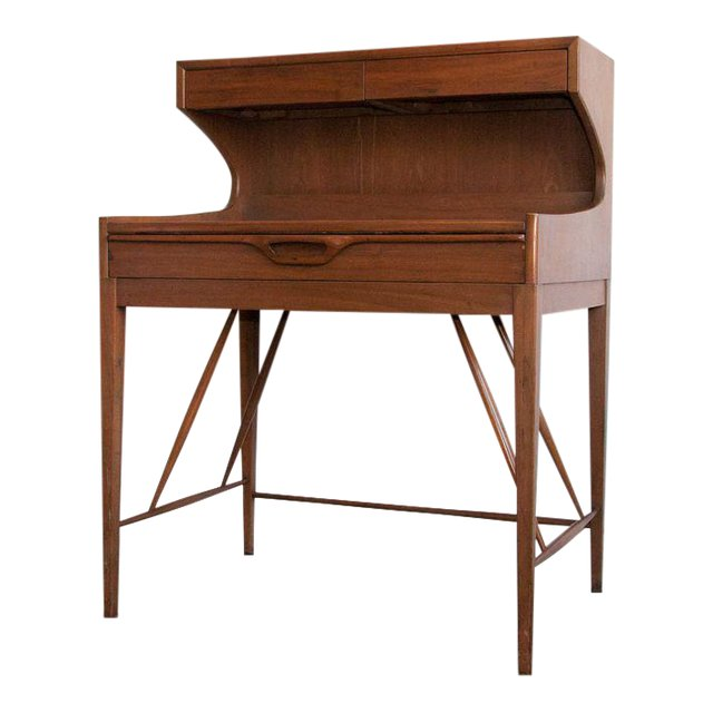 A delightful teak mid-century Danish modern secretaire (secretary) design attributed to Arne Wahl Iversen. A gorgeous example of the 50's and 60's clean, elegant and timeless aesthetic. The secretaire is multi-functional as a simple writing desk or workstation, creative vanity, kitchen essentials display or permanent bar cart.