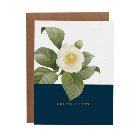 "Get Well Soon Greeting Card with White Magnolia Flower over a large blue rectangle. The phrase ""Get Well Soon"" is in yellow type."