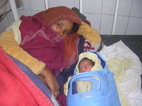 Shamko and her baby in an Embrace infant warmer