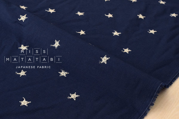 Embroidered metallic stars lawn - metallic gold, navy blue