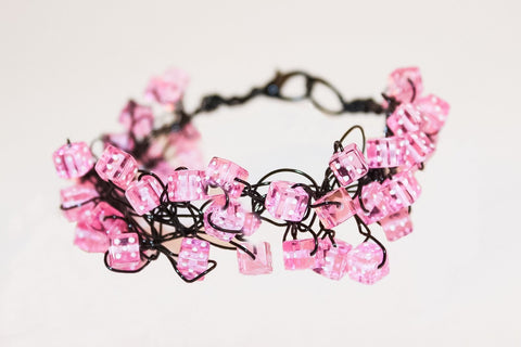 Pink dice and black artistic wire bracelet