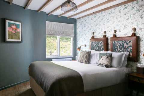 A wool blanket from The British Blanket Company is spread across a bed at the Castle Inn Lulworth