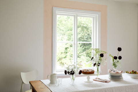 Here, delicate off-white walls painted in Earthborn's Up Up Away are complemented by a strip of Peach Baby, perfectly highlighting a feature window