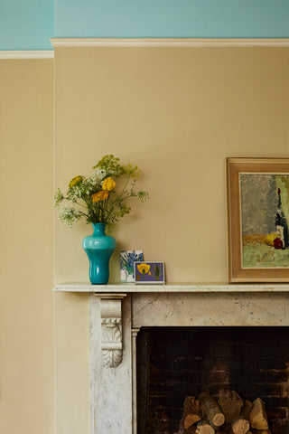 Earthborn's mellow paint shade Crocky Road provides a flattering backdrop to vivid green and yellow foliage