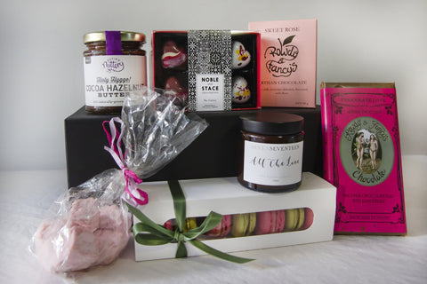 A variety of Treats from Sussex laid out on display for Mother's Day hamper