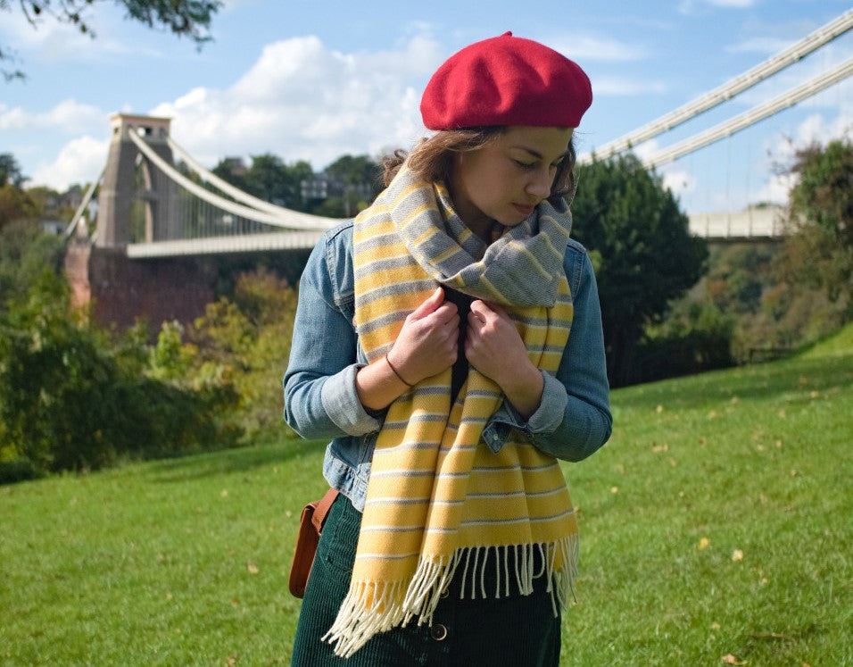 Bethan wears wool blanket scarf beside clifton suspension bridge bristol uk
