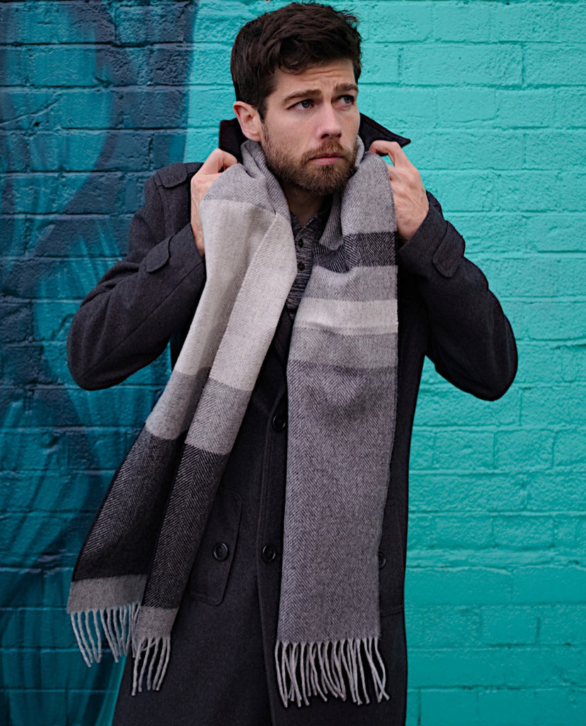 joe wears wool blanket scarf draped over shoulderes