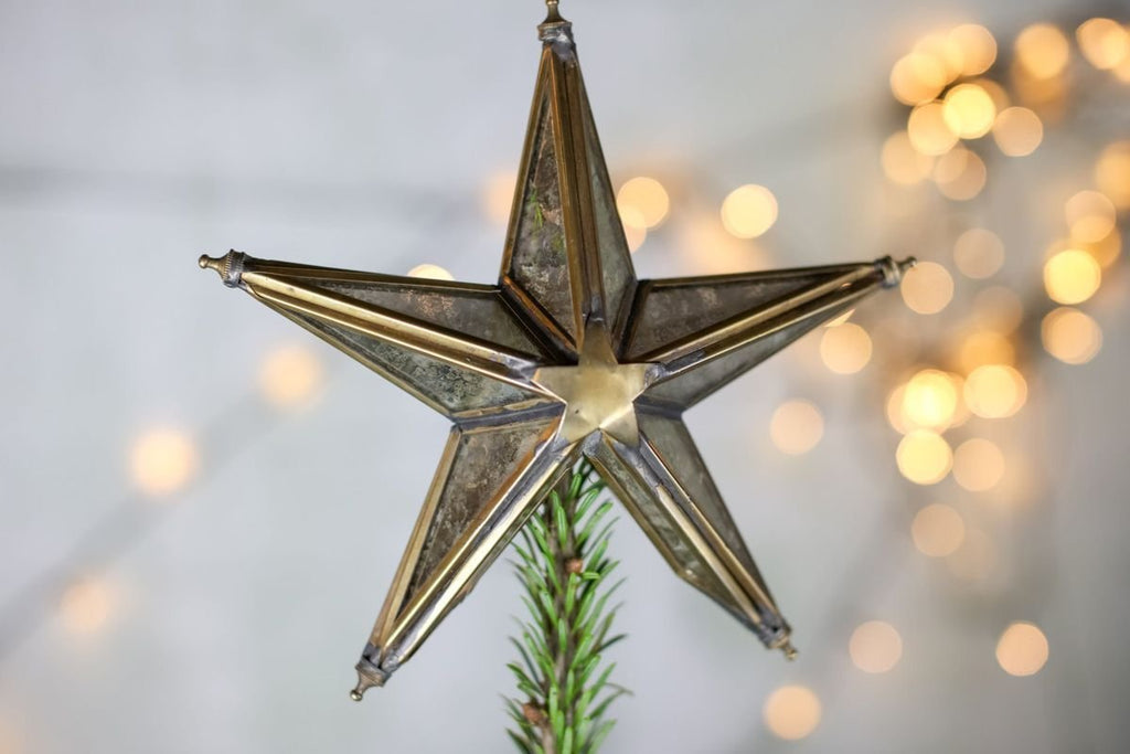 this brass star treetopper makes for cosy christmas decorations