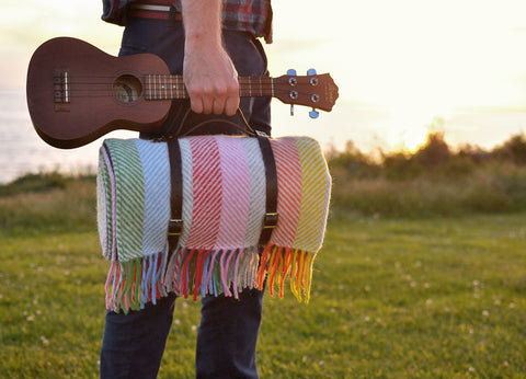 Our wool Rainbow picnic blanket at sunset