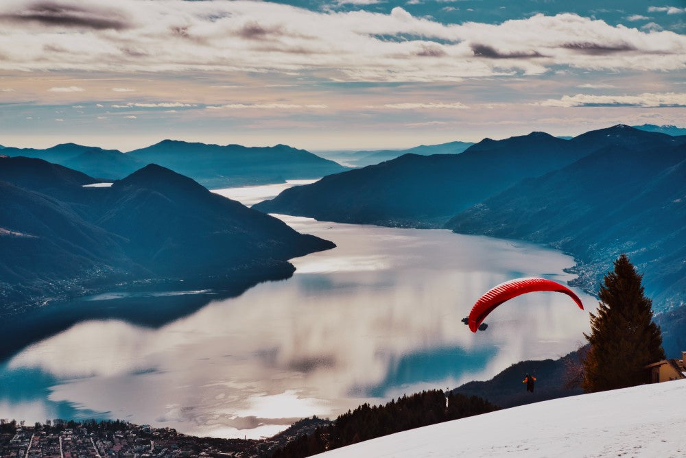 paraglider over lake and mountains - wedding gift ideas