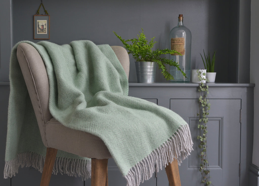 green and grey woollen blanket