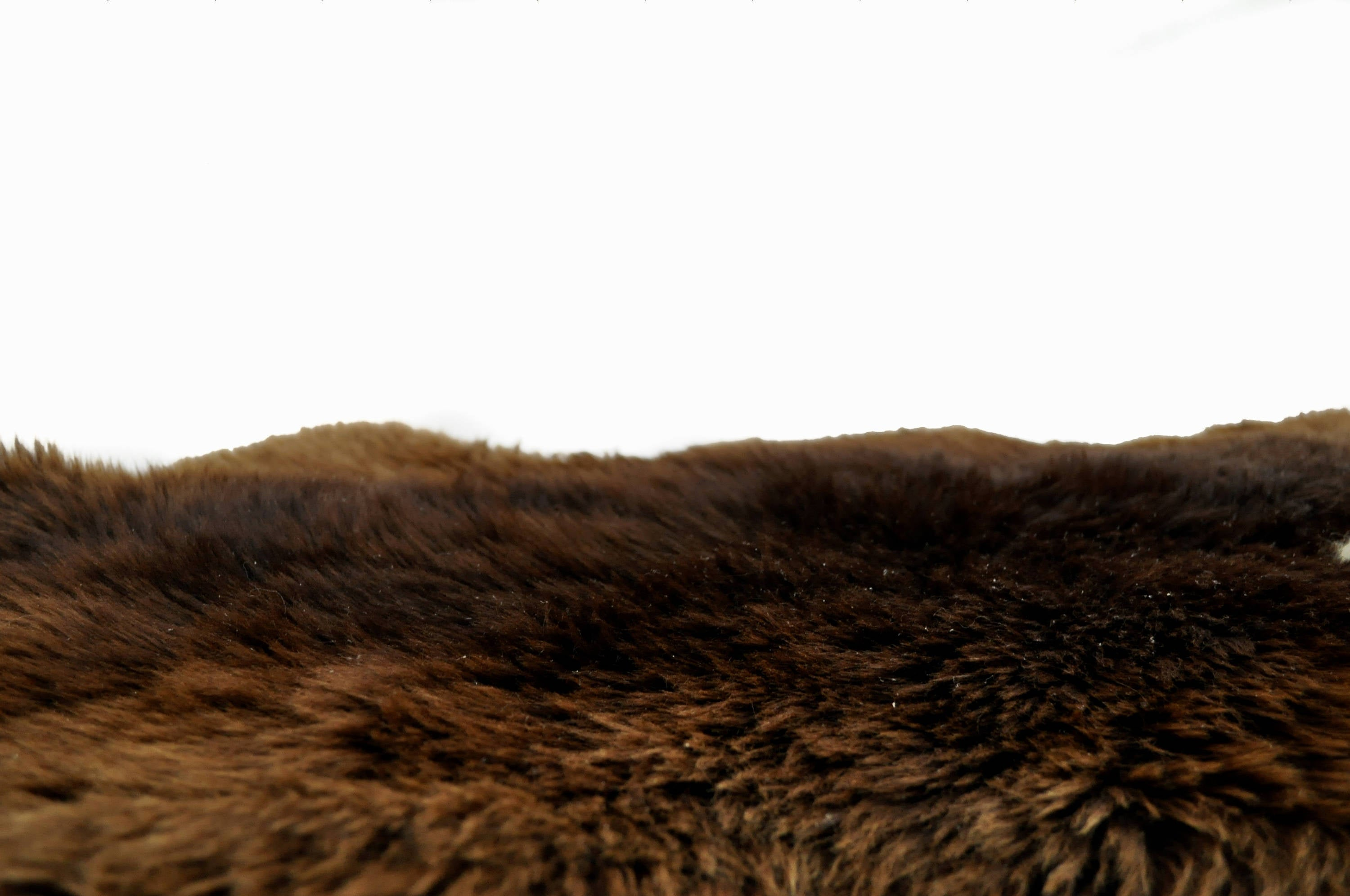 Great Natural Deep Brown Sheepskin with gold shades.