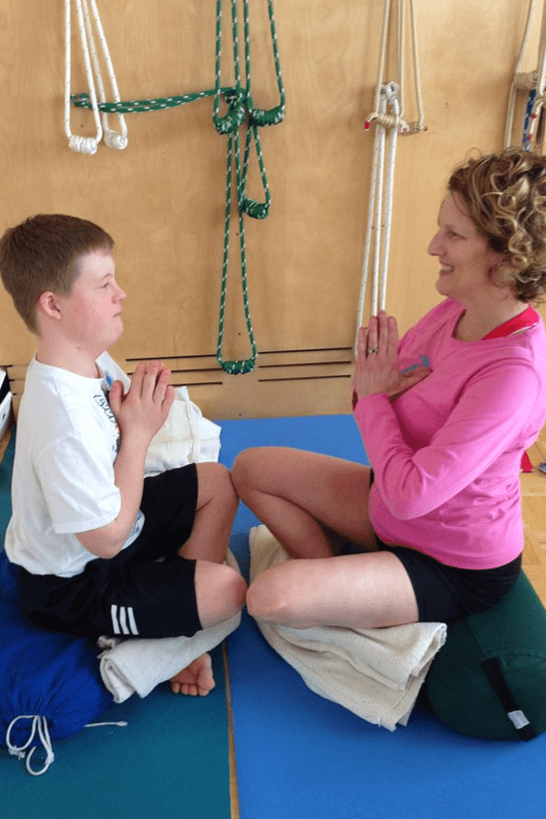 Boy with special needs doing yoga