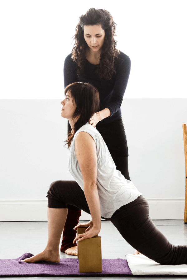 Yoga teacher adjusting in Therapy Yoga