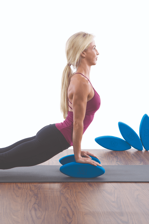 Woman on a mat doing yoga