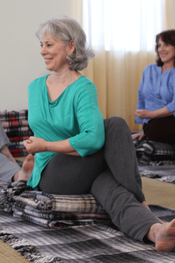 Woman in a Svaroopa yoga class
