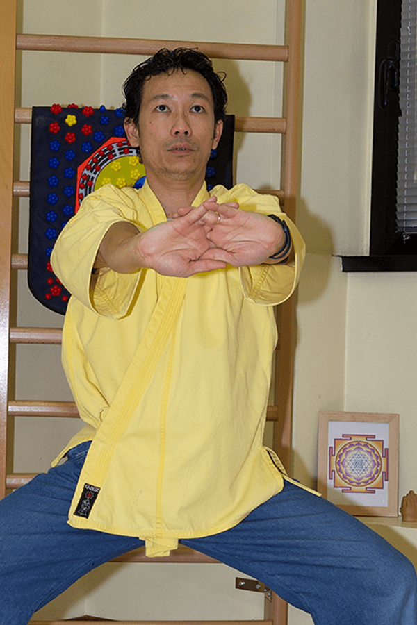 Man performing Okido yoga