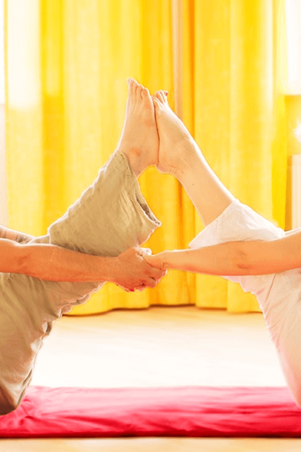 Couple practicing tantra yoga pose