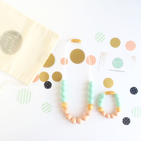 Zoe Silicone Teething Necklace & Bracelet Set - Mint, Gold & Peach