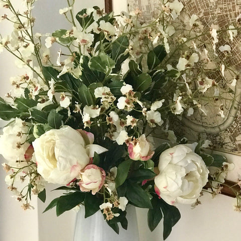 white peony, oncidium and greenery bouquet