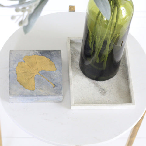 grey trinket box with brass ginko leaf