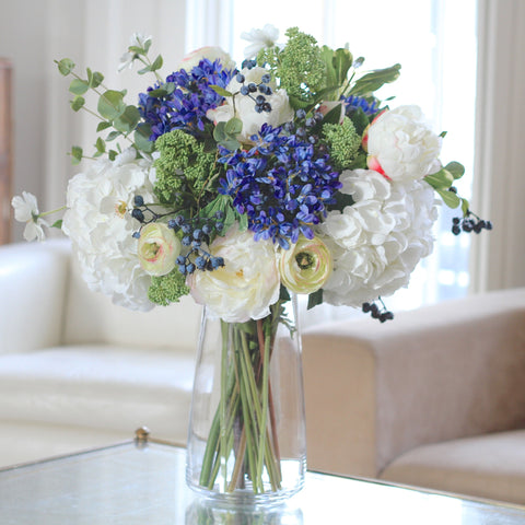 blue agapanthus, white hydrangea and skimmia bouquet