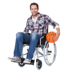 Man in wheelchair holding basketball