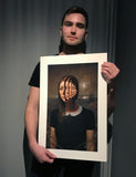 Miles Johnston holding one of his fine art prints.