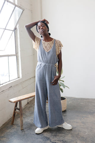 Wide leg jumpsuit with waist tie and front pockets | Love Faustine